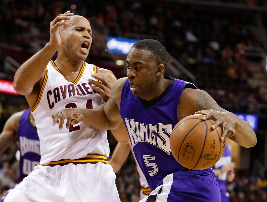 . Sacramento Kings\' James Anderson (5) drives past Cleveland Cavaliers\' Richard Jefferson (24) in the second half of an NBA basketball game Monday, Feb. 8, 2016, in Cleveland. The Cavaliers won 120-100. (AP Photo/Tony Dejak)
