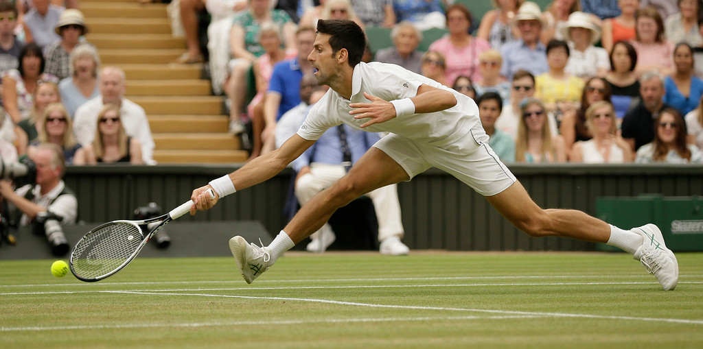 . Serbia\'s Novak Djokovic returns the ball to Rafael Nadal of Spain during their men\'s singles semifinals match at the Wimbledon Tennis Championships, in London, Saturday July 14, 2018.(AP Photo/Tim Ireland)