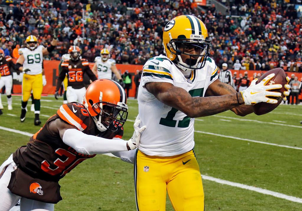 . Green Bay Packers wide receiver Davante Adams (17) catches a 1-yard pass for a touchdown under pressure from Cleveland Browns defensive back Jason McCourty (30) in the second half of an NFL football game, Sunday, Dec. 10, 2017, in Cleveland. (AP Photo/Ron Schwane)