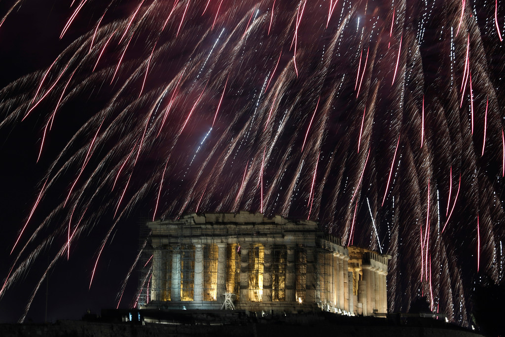 . Fireworks explode over the temple of the Parthenon at the Acropolis hill to mark the New Year\'s celebrations in Athens, Greece, Monday, Jan. 1, 2018. (AP Photo/Yorgos Karahalis)