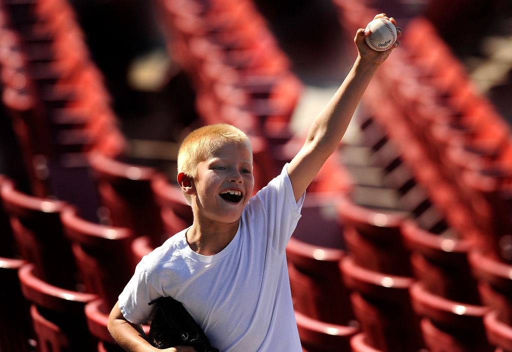 ". ""I got two!\"" exclaims Ryan Duran, 9, of Victorville, as he shows his family a foul ball at Mavericks Stadium in Adelanto June 3, 2012.  Ryan was out with his family when he successfully acquired two foul balls during the Mavericks vs. Sixty-Sixers game.  GABRIEL LUIS ACOSTA/STAFF PHOTOGRAPHER."