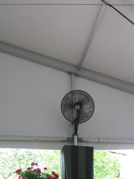 A fan inside the Midway Stage tent.
