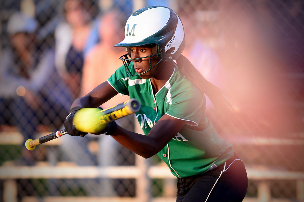 . Monrovia\'s Elise McCarthy (4) makes a  bunt during the West SGV softball all-star game Wednesday night, June 11, 2014 at Live Oak Park in Temple City. (Photo by Sarah Reingewirtz/Pasadena Star-News)