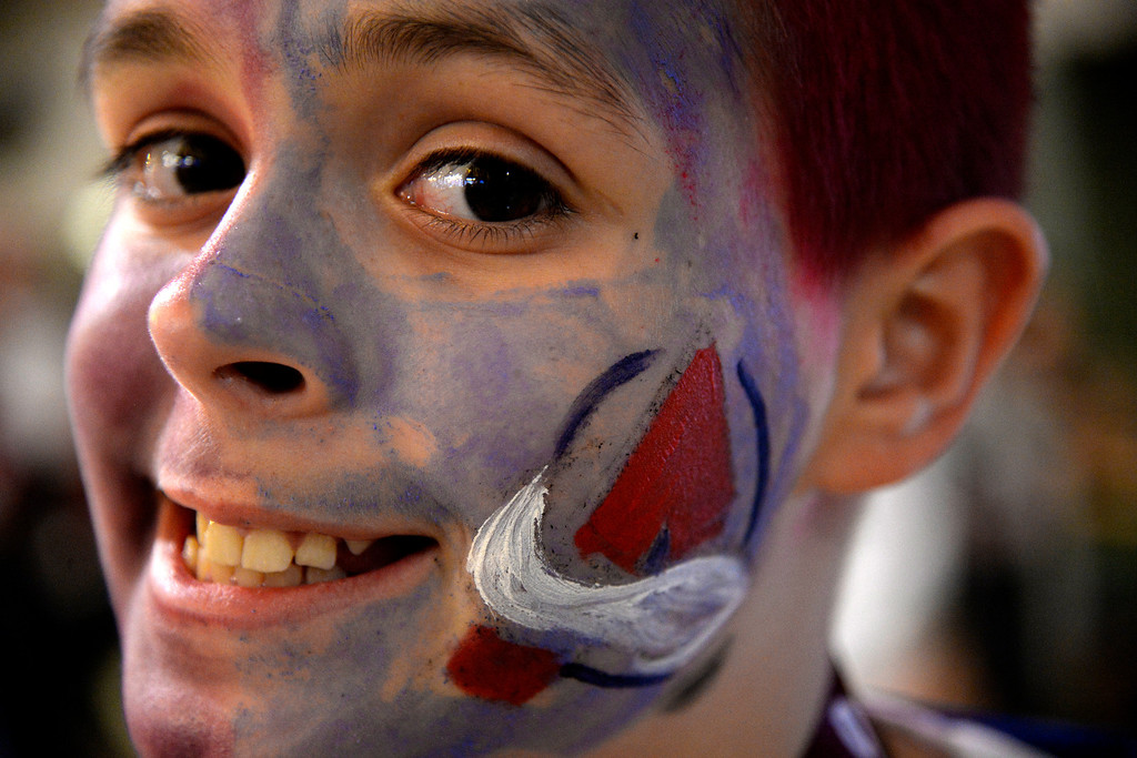 . Ben McManus, 11, rocks Avs face paint during the first period of action. The Colorado Avalanche hosted the Minnesota Wild in the first round of the Stanley Cup Playoffs at the Pepsi Center on Saturday, April 19, 2014. (Photo by AAron Ontiveroz/The Denver Post)
