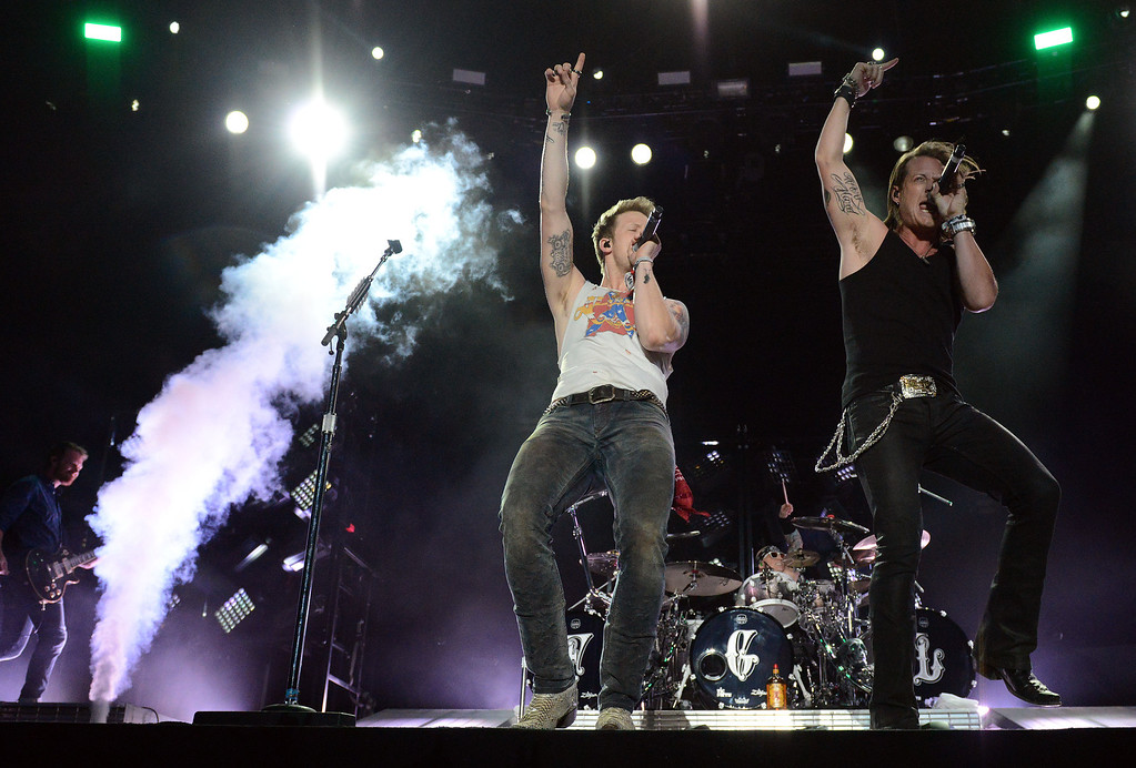 . Florida Georgia Line\'s Tyler Hubbard (dark shirt) and Brian Kelley (white shirt) perform on the Mane Stage on the final day of the 2014 Stagecoach Country Music Festival Sunday April 27, 2014 at the Empire Polo Club in Indio. (Will Lester/Inland Valley Daily Bulletin)