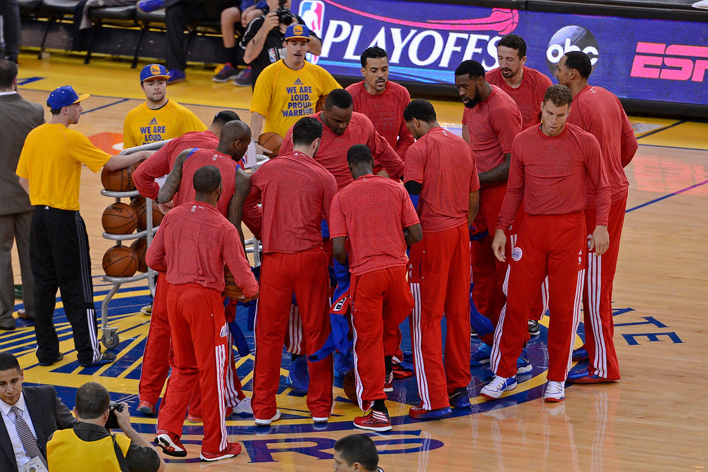 . Los Angeles Clippers remove their warm up jackets in sign of protest over the alleged racist remarks made by their owner Donald Sterling before playing the Golden State Warriors in Game 4 of their Western Conference NBA playoff at Oracle Arena in Oakland, Calif., on Sunday, April 27, 2014. (Jose Carlos Fajardo/Bay Area News Group)