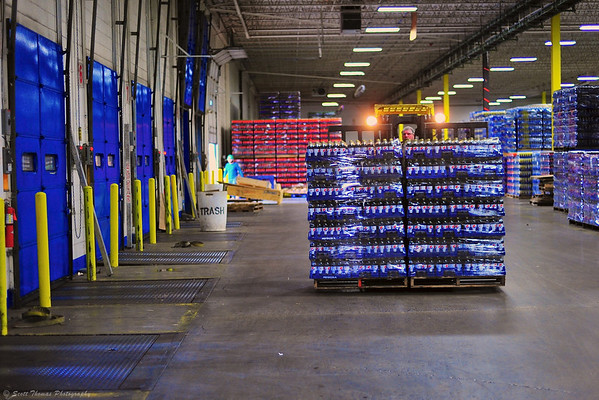 Two pallets of Pepsi Cola being loaded onto a trailer.