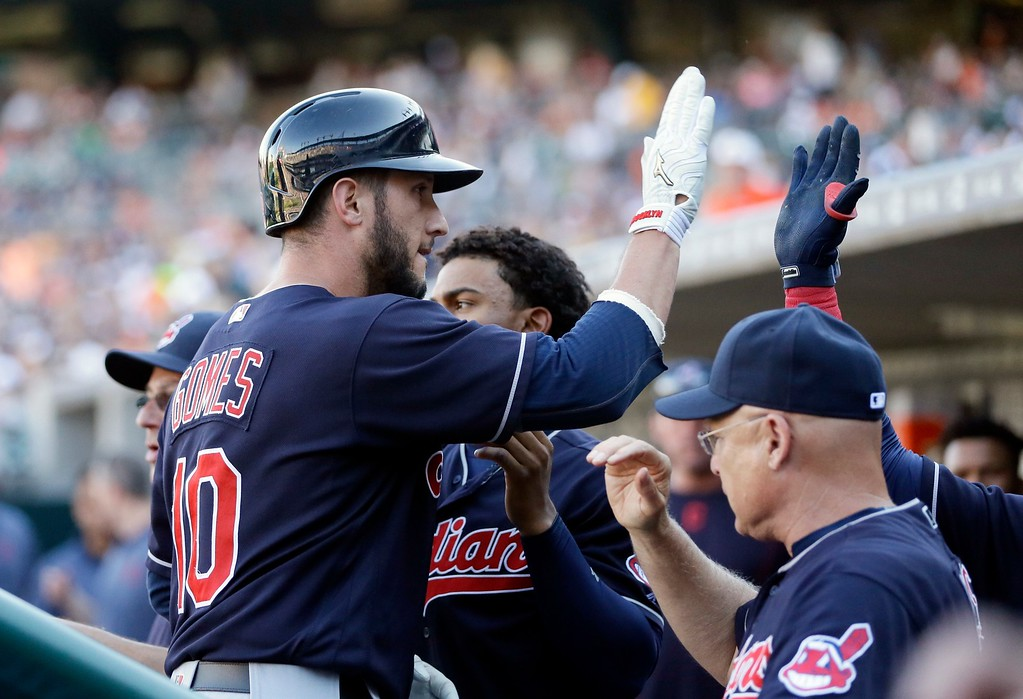 . Cleveland Indians\' Yan Gomes arrives in the dugout after a solo home run in the ninth inning of a baseball game against the Detroit Tigers, Saturday, June 25, 2016, in Detroit. The Indians defeated the Tigers 6-0. (AP Photo/Carlos Osorio)