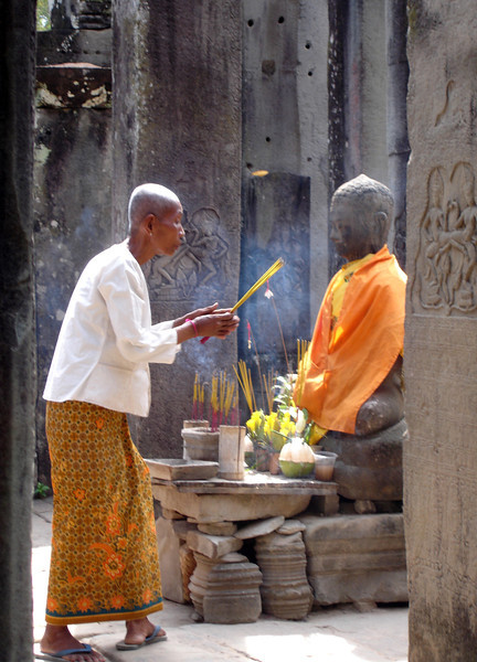 Buddhist nun at the Bayon Temple, Angkor Thom