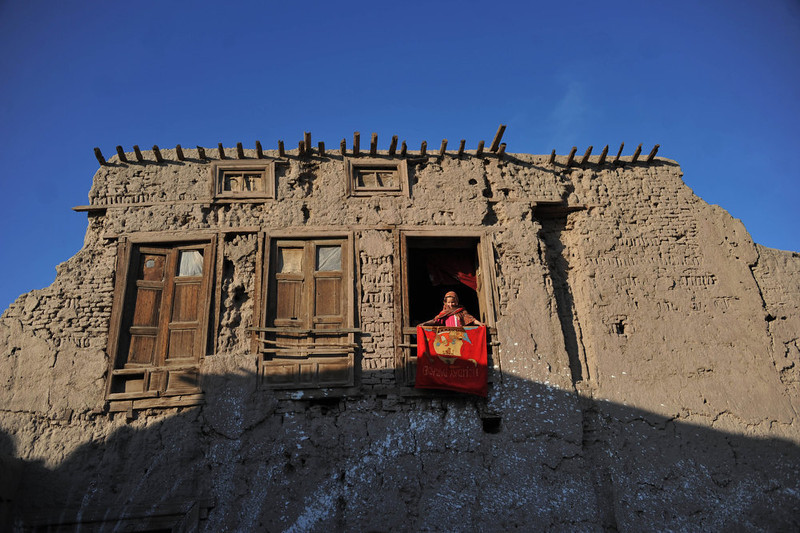 . An Afghan girl looks through the window of a residence in the outskirts of Jalalabad on December 26, 2012. Over a third of Afghans are living in abject poverty, as those in power are more concerned about addressing their vested interests rather than the basic needs of the population, a UN report said. Noorullah Shirzada/AFP/Getty Images