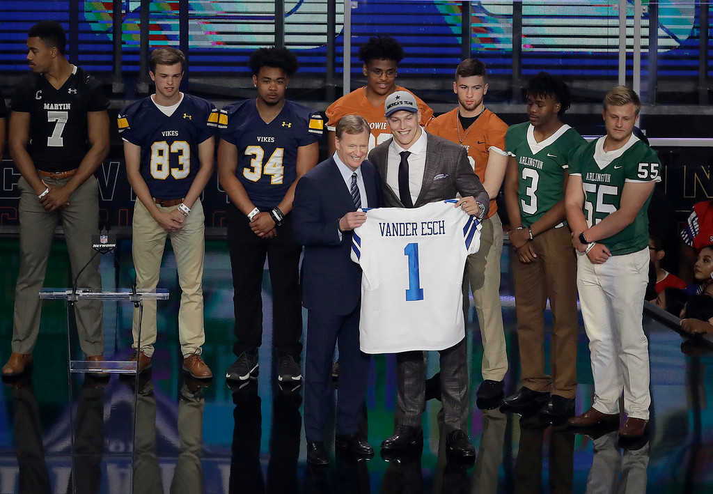 . Commissioner Roger Goodell presents Boise State\'s Leighton Vander Esch with his Dallas Cowboys team jersey as the two stand surrounded by area high school football players during the first round of the NFL football draft, Thursday, April 26, 2018, in Arlington, Texas. (AP Photo/Eric Gay)