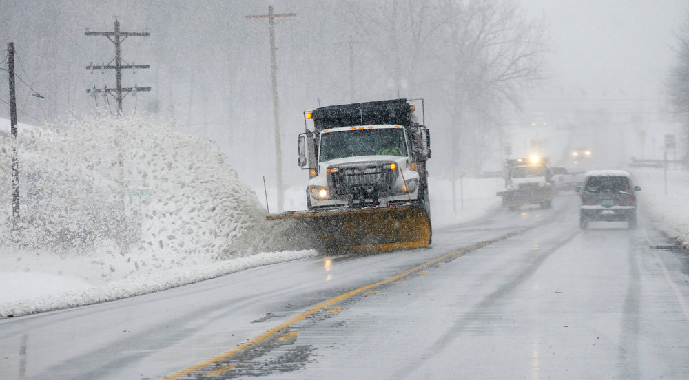 Description of . Kentucky Transportation Cabinet snowplows head south on U.S. 41 in Henderson, Ky. as blizzard conditions Wednesday, Dec. 26, 2012 made travel difficult. (AP Photo/The Gleaner, Mike Lawrence)