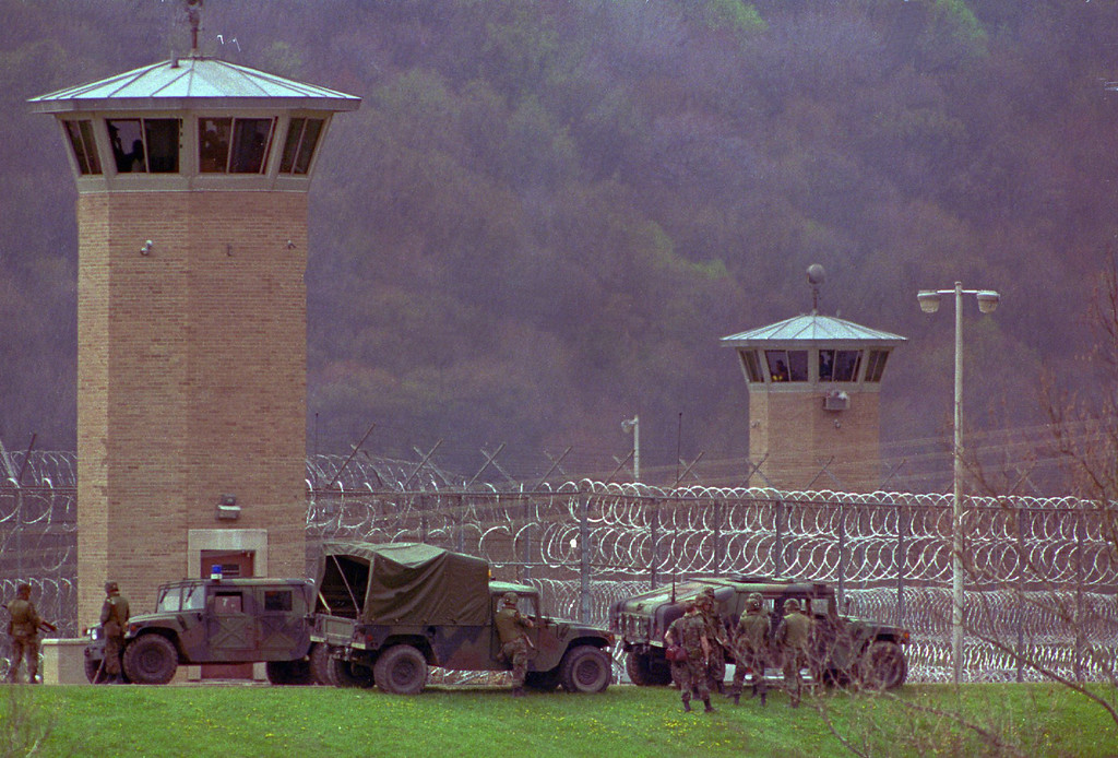 . FILE - This April 28, 1993 file photo shows law officers and National Guard troops assembling outside the Southern Ohio Correctional Facility as a riot by inmates enters its 10th day in Lucasville, Ohio. In the 20 years since the nation\'s longest deadly prison riot broke out in Lucasville, no interviews have been granted with the five men sentenced to death in the killing of a guard. Yet time has brought new evidence and insights that will dominate events marking the 20th anniversary of the 11-day siege of April 1993. (AP Photo/Mark Duncan, File)