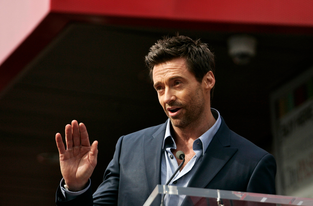 Description of . Actor Hugh Jackman speaks during ceremonies honoring him with a star on the Hollywood Walk of Fame in Hollywood, California, December 13, 2012. REUTERS/Jonathan Alcorn
