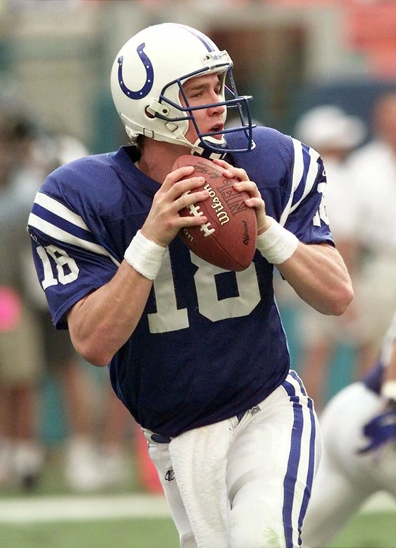 . Indianapolis Colts quarterback Peyton Manning drops back in the pocket to make a pass during the second at Pro Player Stadium in Miami Sunday Nov. 8, 1998. Manning was held to 140 passing yards completing 22 of 42 attempts with two interceptions and one touchdown in the Colts 27-14 loss. (AP Photo/Tony Gutierrez)