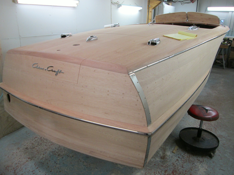 Starboard view of new stainless steel rub rail fit along with transom guards.