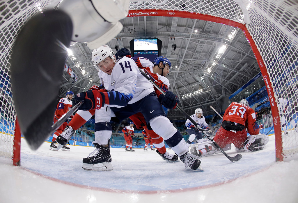 . Ondrej Vitasek (74), of the Czech Republic, checks Broc Little (14), of the United States, during the first period of the quarterfinal round of the men\'s hockey game at the 2018 Winter Olympics in Gangneung, South Korea, Wednesday, Feb. 21, 2018. (AP Photo/Matt Slocum, Pool)