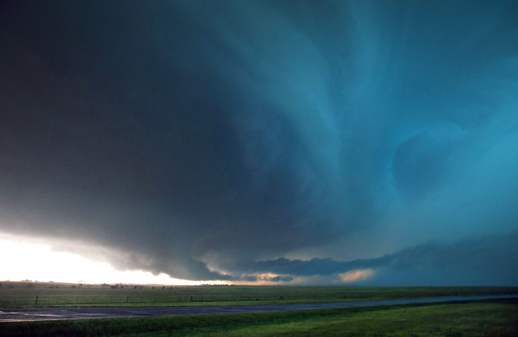 . A storm develops just before it produced a tornado near El Reno, Okla. just south of Interstate 40 on Friday, May 31, 2013. Several tornadoes in the area caused damage and injuries. (AP Photo/The World-Herald, Chris Machian)