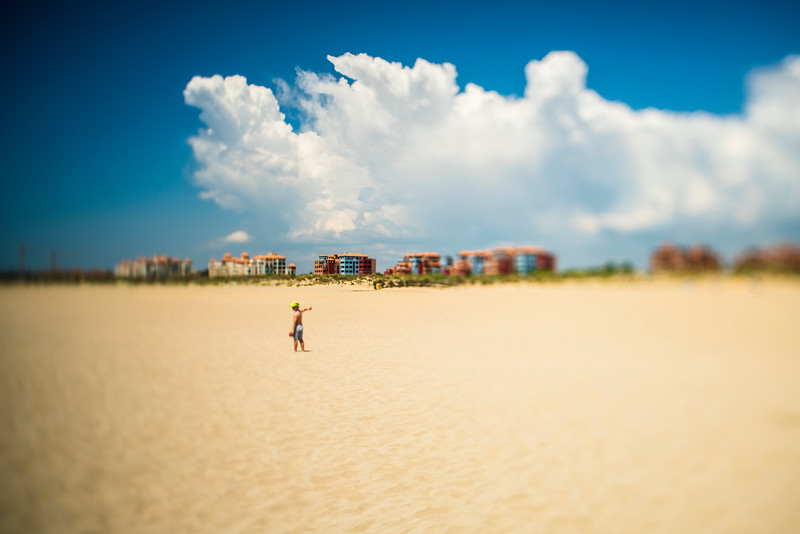 A kid alone on the beach, Ayamonte, Spain. A tilted lens was used for a shallower depth of field.
