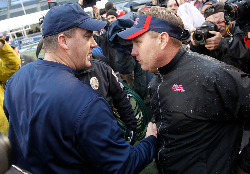 . Pittsburgh head coach Paul Chryst, left, congratulates Mississippi head coach Hugh Freeze following the BBVA Compass Bowl NCAA college football game at Legion Field in Birmingham, Ala., Saturday, Jan. 5, 2013. Mississippi won 38-17. (AP Photo/Butch Dill)