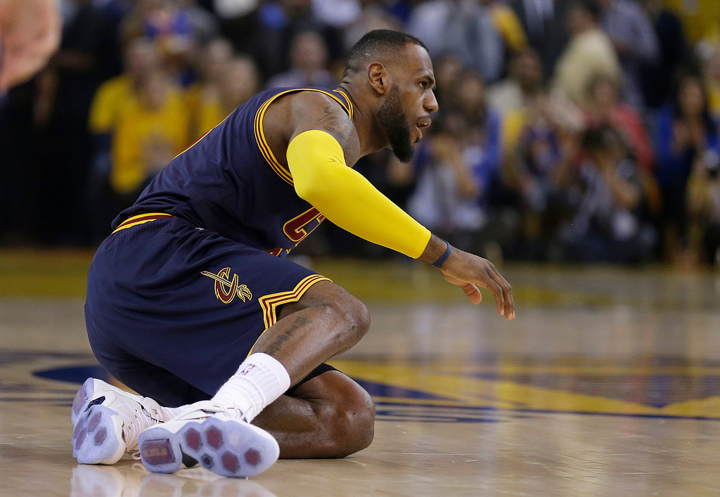 . Cleveland Cavaliers forward LeBron James (23) gets off the ground during the first half of Game 1 of basketball\'s NBA Finals against the Golden State Warriors in Oakland, Calif., Thursday, June 4, 2015. (AP Photo/Ben Margot)