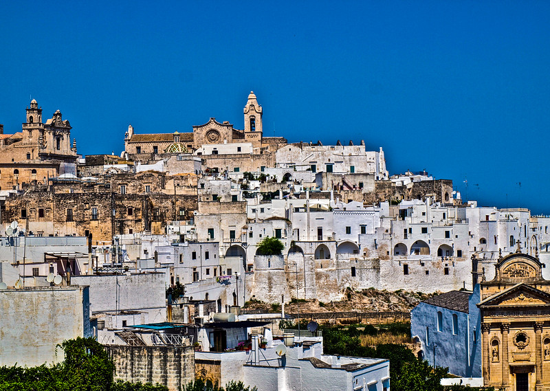 Church dome with majolica tiles (supposed to look like fish scales)...View of the Cathedral of Ostuni from the lower part of the town...Ostuni...La Città Bianca