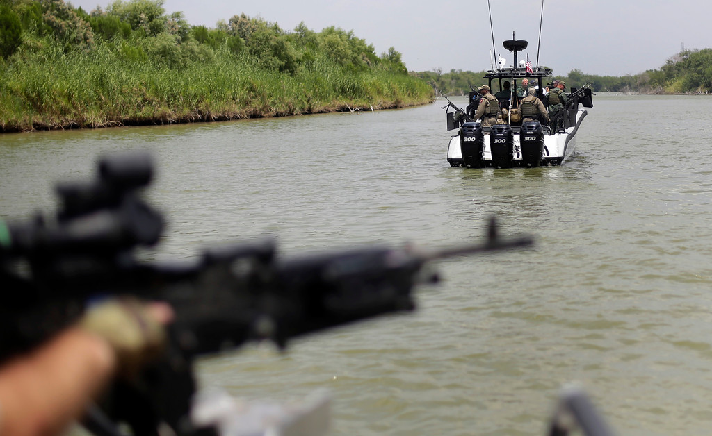 . In this Thursday, July 24, 2014 file photo, Texas Department of Safety Troopers patrol the Rio Grande along the U.S.-Mexico border in Mission, Texas. Frustrated by an impasse in Congress, President Barack Obama took executive actions in November 2014 to curb deportations for many immigrants residing in the U.S. illegally. GOP leaders in the House and Senate pledged efforts to block the president\'s moves. Prospects for reform legislation were dimmed earlier in the year by the influx of unaccompanied Central American minors arriving at the U.S. border, causing shelter overloads and case backlogs. (AP Photo/Eric Gay, Pool, File)
