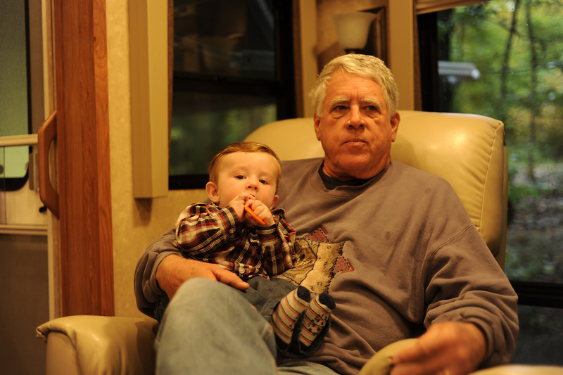 Jack chews on his rattle with Grandpa Spiegelhalter