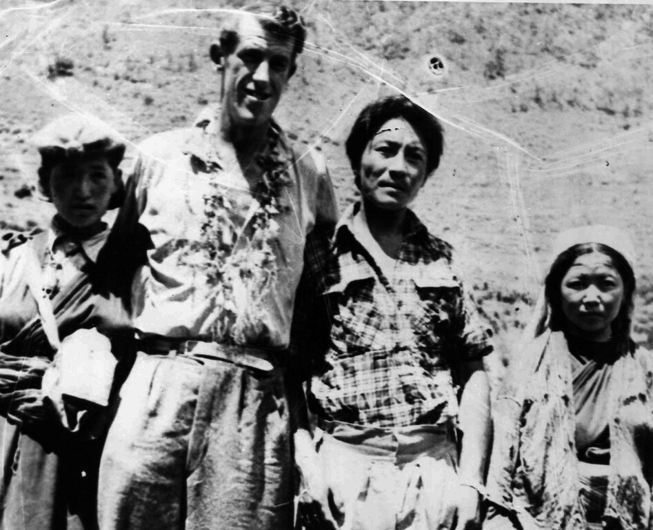 . Edmund Hillary, second from left, of the British Everest Expedition, who with the Sherpa Tenzing Norgay, was the first to make the ascent of the peak of Mt. Everest.  He stands with Tenzing, third from left, and two of Tenzing\'s nieces, Droma, left, and Phulima, far right, who climbed with the expedition to 23,000 feet.  Photo was made at Dhullal Ghat, after the returning party descended from Namche Bazar June 19, 1953.  (AP Photo)