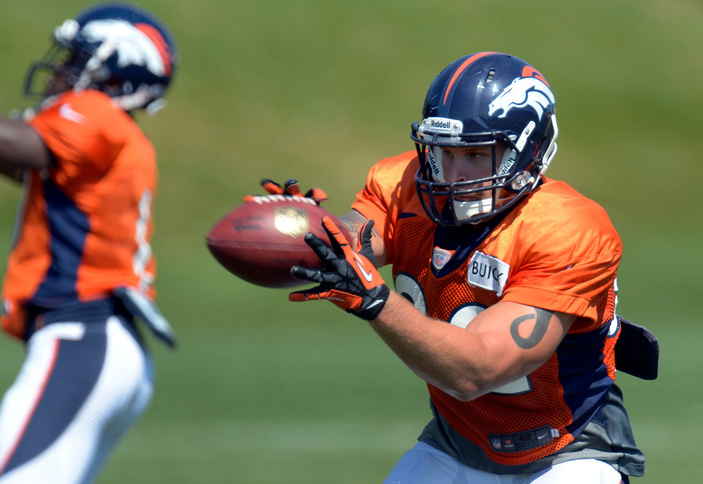 . Denver Broncos running back Jacob Hester (22) ctches a pass during practice August 20, 2013 at Dove Valley (Photo by John Leyba/The Denver Post)