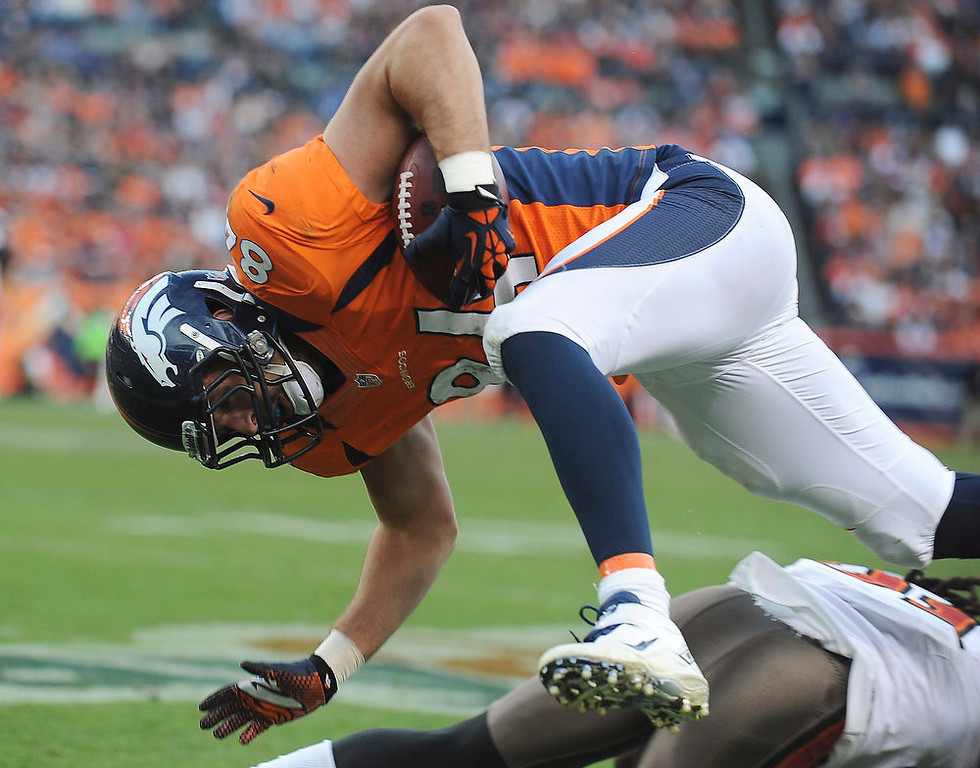 . DENVER - Denver Broncos tight end Jacob Tamme is upended after a short gain in the third quarter against Tampa Bay Sunday at Sports Authority Field. Steve Nehf, The Denver Post