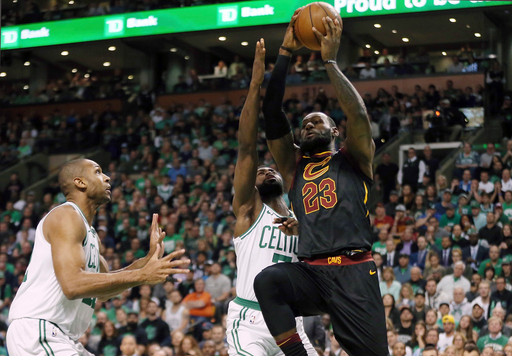 . Cleveland Cavaliers forward LeBron James (23) drives against Boston Celtics forward Al Horford, left, and guard Jaylen Brown, rear, during the first half in Game 7 of the NBA basketball Eastern Conference finals, Sunday, May 27, 2018, in Boston. (AP Photo/Elise Amendola)