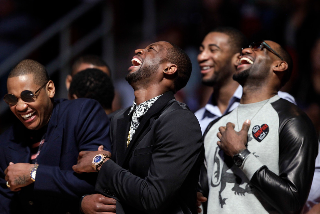. From left, Carmelo Anthony of the New York Knicks joins Dwyane Wade and LeBron James of the Miami heat watch a replay at the dunk contest during NBA All-Star Saturday Night basketball Saturday, Feb. 16, 2013, in Houston. (AP Photo/Eric Gay)