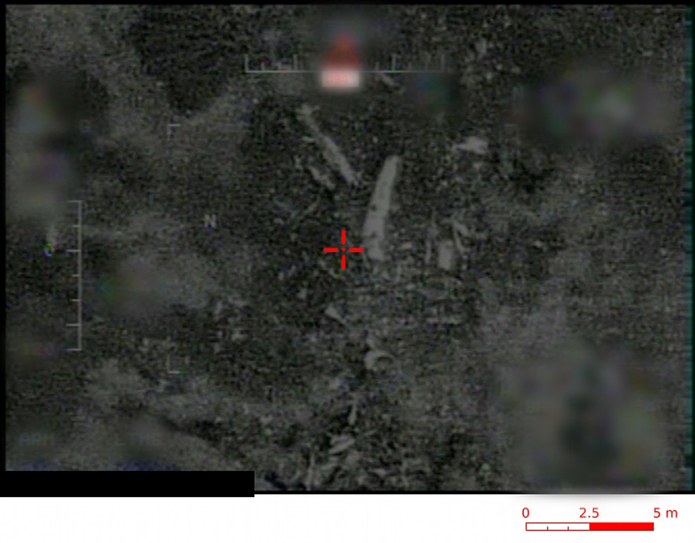. This photo provided Friday July 25, 2014 by the French army shows the site of the plane crash in Mali, taken by night by a Reaper drone with InfraRed technology. French soldiers secured a black box from the Air Algerie wreckage site in a desolate region of restive northern Mali on Friday, the French president said.  (AP Photo/ECPAD)