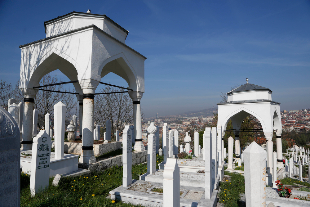 . In this Tuesday, April 8, 2014 photo, an old cemetery overlooks the city of Sarajevo. While Sarajevo shares the scars of more recent wars, it is World War I that will be the focus in the coming months as the city hosts a series of events around the Centenary, including a conference of historians and concerts. (AP Photo/Amel Emric)