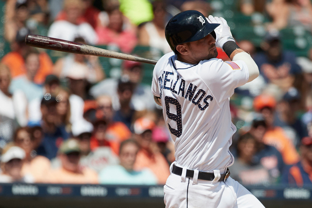 . Detroit Tigers Nicholas Castellanos hits an RBI triple against the Cleveland Indians during the seventh inning in the first baseball game of a doubleheader in Detroit, Saturday, July 1, 2017. (AP Photo/Rick Osentoski)