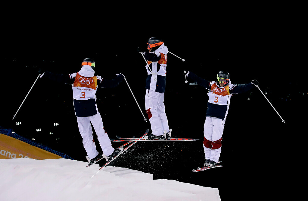 . In this multiple exposure photo, Perrine Laffont, of France, jumps during the women\'s moguls finals at Phoenix Snow Park at the 2018 Winter Olympics in Pyeongchang, South Korea, Sunday, Feb. 11, 2018. (AP Photo/Gregory Bull)