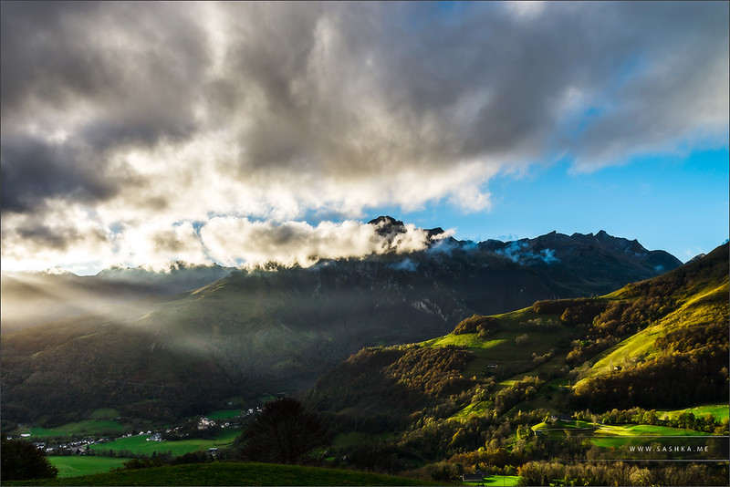 Sun rays lighting through the clouds in high Pyrenees