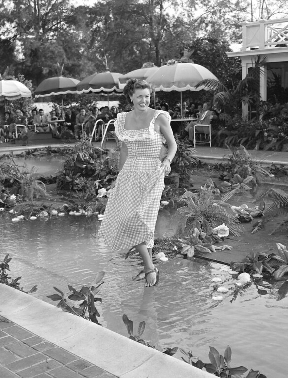 . Actress and swimmer Esther Williams is seen modeling a Cole of California sun=dress in this September 1949 photo, in Beverly Hills, Calif.  A hidden plastic runway just beneath the surface of the water creates the effect of her walking on water.   (AP Photo)