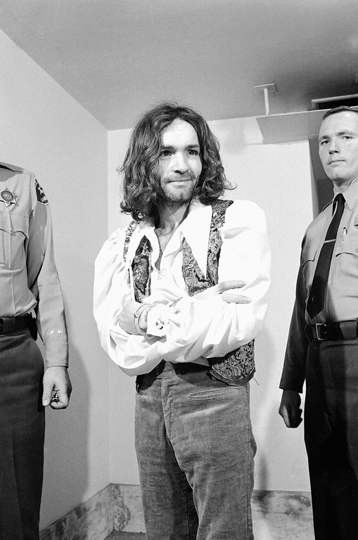 . Charles M. Manson, charged in the killings of actress Sharon Tate and six others, walks to courtroom in Los Angeles, Feb. 10, 1970, where his trial date was set for March 30. Manson is wearing sandals, gold velvet trousers, a white Edwardian shirt with billowing sleeves and a multi-colored vest. The same trial date was set for Linda Kasabian and Leslie Van Houten, two female co-defendants. (AP Photo/Wally Fong)