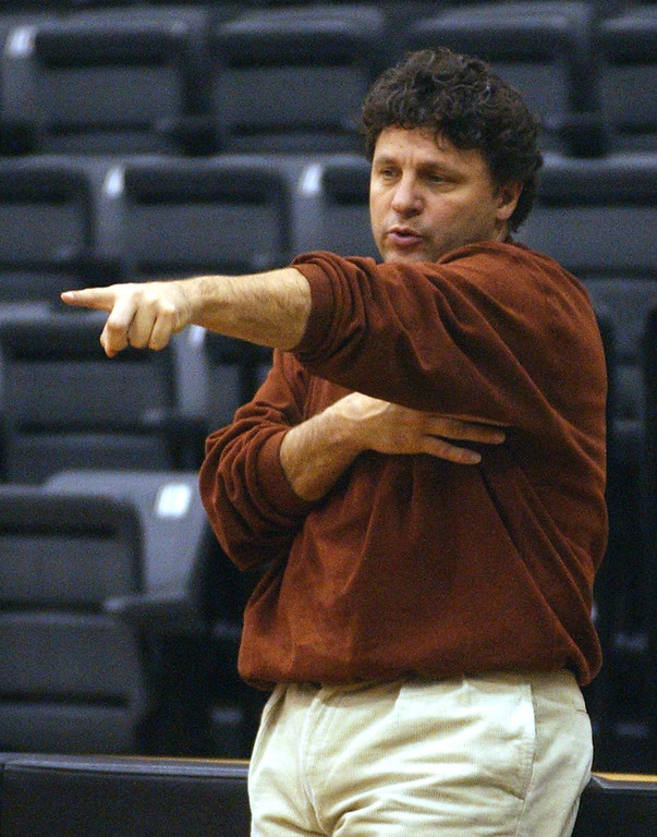 . Oakland University mens head basketball coach Greg Kampe gives instructions to his team during practice Monday November 18, 2002 at Oakland University.