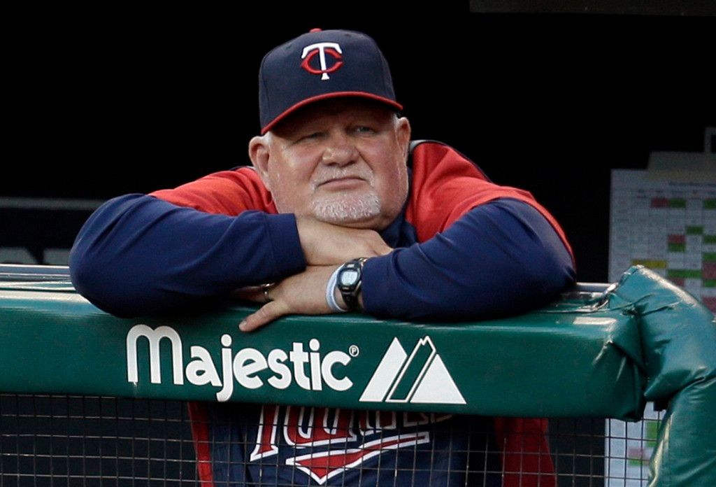 . Twins manager Ron Gardenhire settles in during the first inning as he watches starter Samuel Deduno work against the Indians. (AP Photo/Tony Dejak)