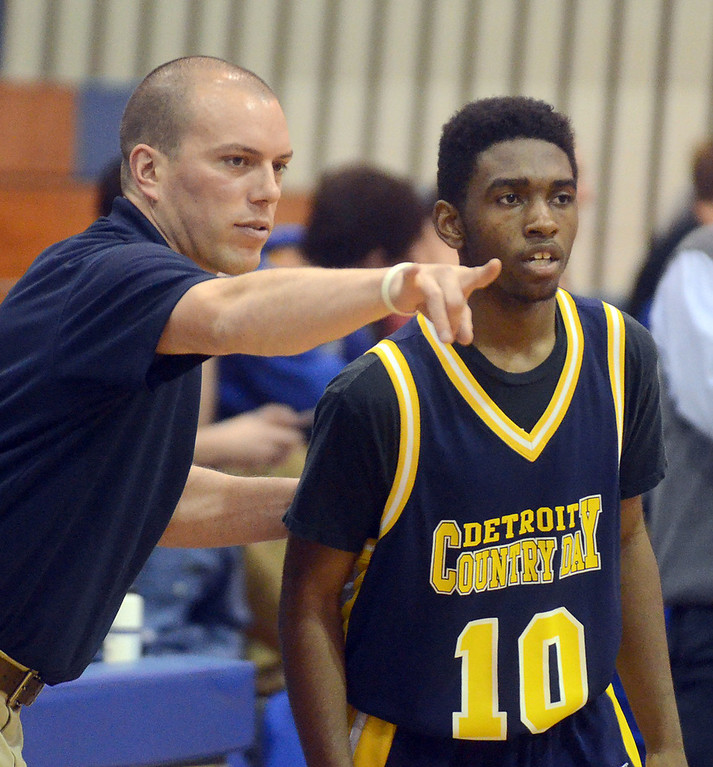 . Detroit Country Day\'s first year coach Mark Bray gives instructions to #10 Darrell Davison Jr. during their game against Walled Lake Western at Walled Lake Western High School, Friday December 13, 2013. Western went on to win the game 73-69. (Vaughn Gurganian-The Oakland Press)