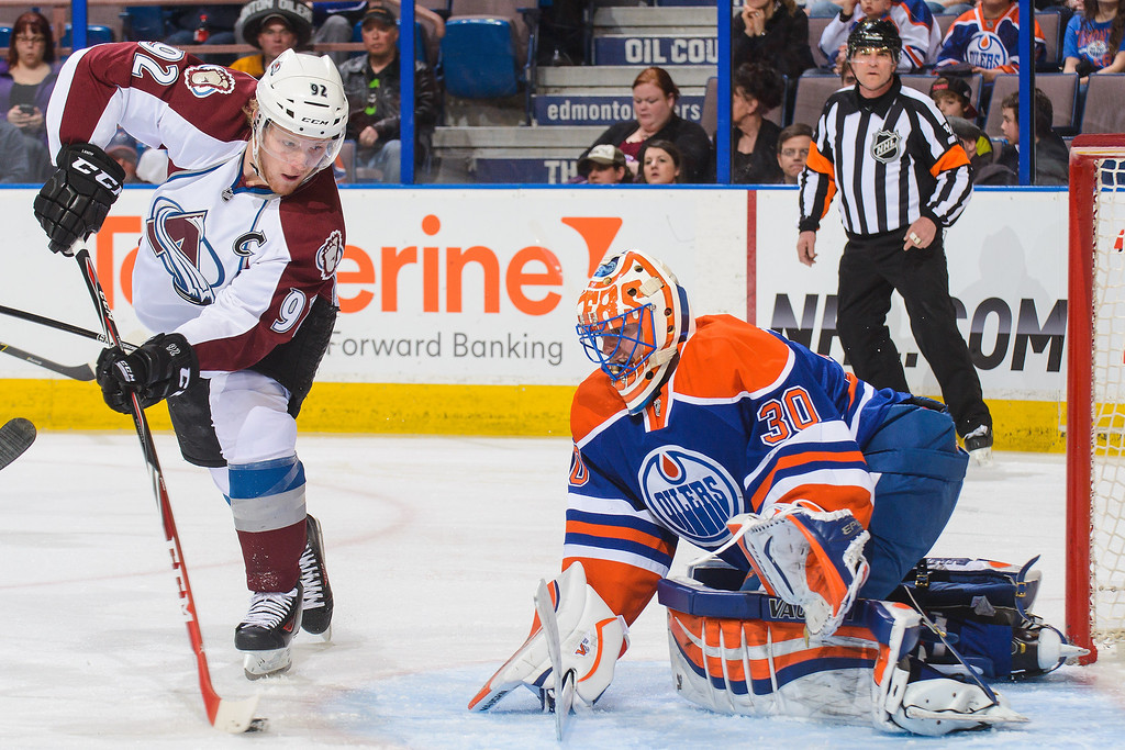 . Ben Scrivens #30 of the Edmonton Oilers stops the shot of Gabriel Landeskog #92 of the Colorado Avalanche during an NHL game at Rexall Place on April 8, 2014 in Edmonton, Alberta, Canada. (Photo by Derek Leung/Getty Images)