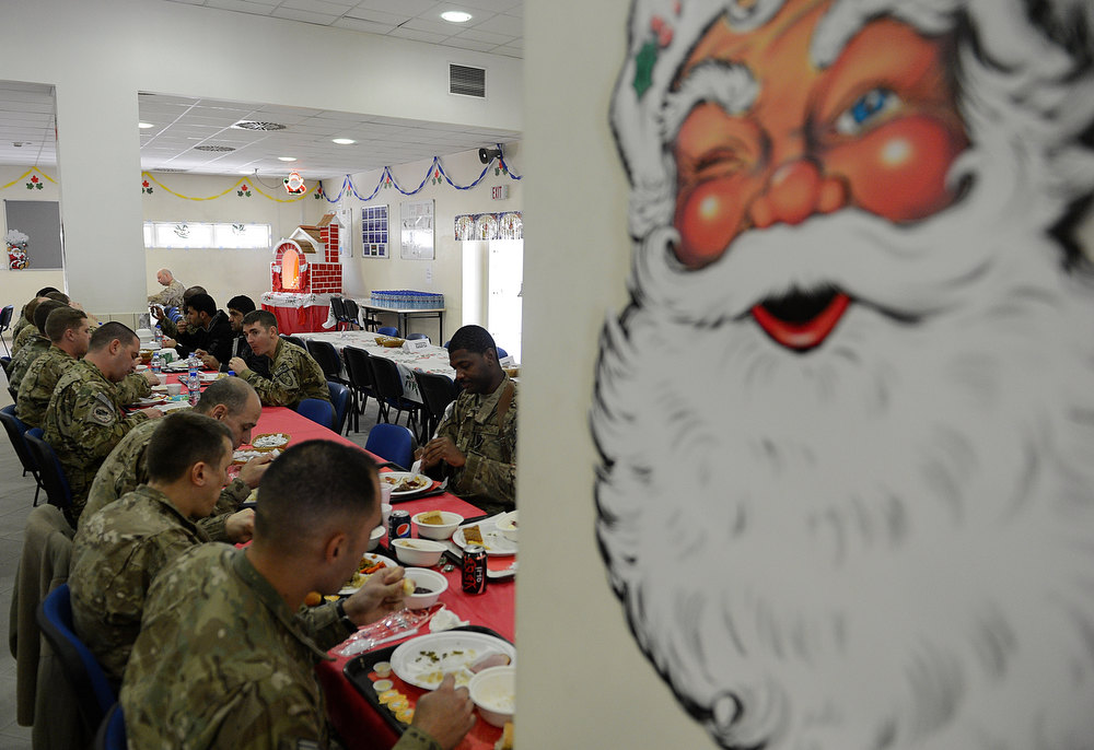 Description of . US soldiers eat their food during a special meal on Christmas Day at Kabul International Airport on December 25, 2012. There are presently around 100,000 US-led NATO troops fighting a decade-long Taliban led insurgency in Afghanistan. Despite the stubborn insurgency, war-weary international forces are seeking to hand control of security to Afghan forces by withdrawing their combat troops by the end of 2014. SHAH MARAI/AFP/Getty Images