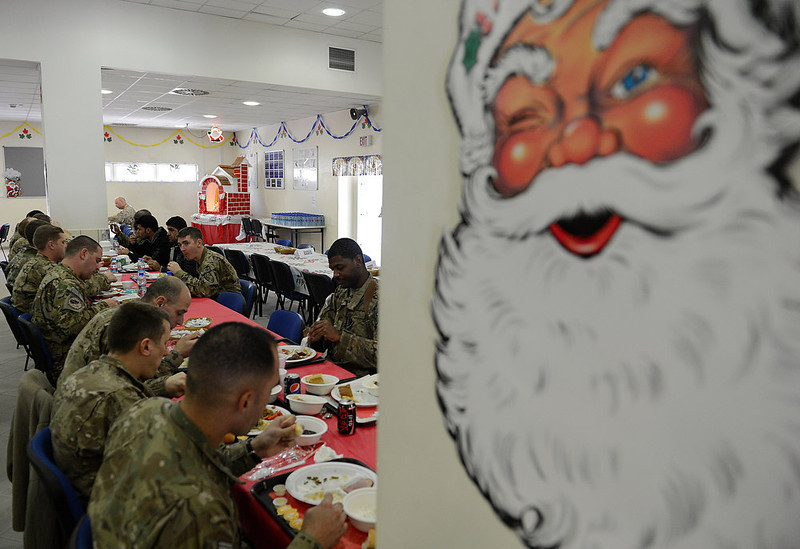 . US soldiers eat their food during a special meal on Christmas Day at Kabul International Airport on December 25, 2012. There are presently around 100,000 US-led NATO troops fighting a decade-long Taliban led insurgency in Afghanistan. Despite the stubborn insurgency, war-weary international forces are seeking to hand control of security to Afghan forces by withdrawing their combat troops by the end of 2014. SHAH MARAI/AFP/Getty Images