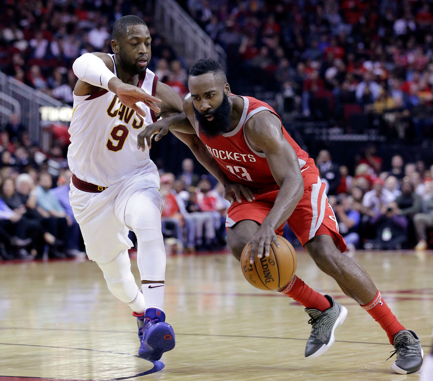 . Houston Rockets guard James Harden (13) drives past Cleveland Cavaliers guard Dwyane Wade (9) during the second half of an NBA basketball game Thursday, Nov. 9, 2017, in Houston. (AP Photo/Michael Wyke)