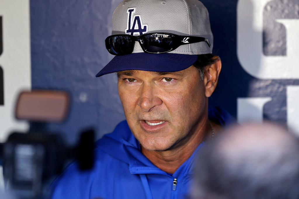 . Los Angeles Dodgers manager Don Mattingly speaks to reporters before a baseball game against the San Diego Padres in San Diego, Wednesday, April 10, 2013. (AP Photo/Lenny Ignelzi)