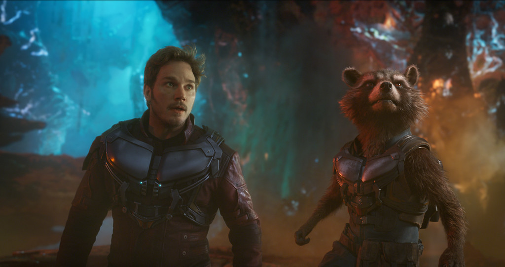 ". Peter, portrayed by Chris Pratt, left, and Rocket, voiced by Bradley Cooper, aren\'t always the best of chums as the fight together in ""Guardians of the Galaxy Vol. 2.\"" The movie is in theaters May 5. (Marvel Studios)"