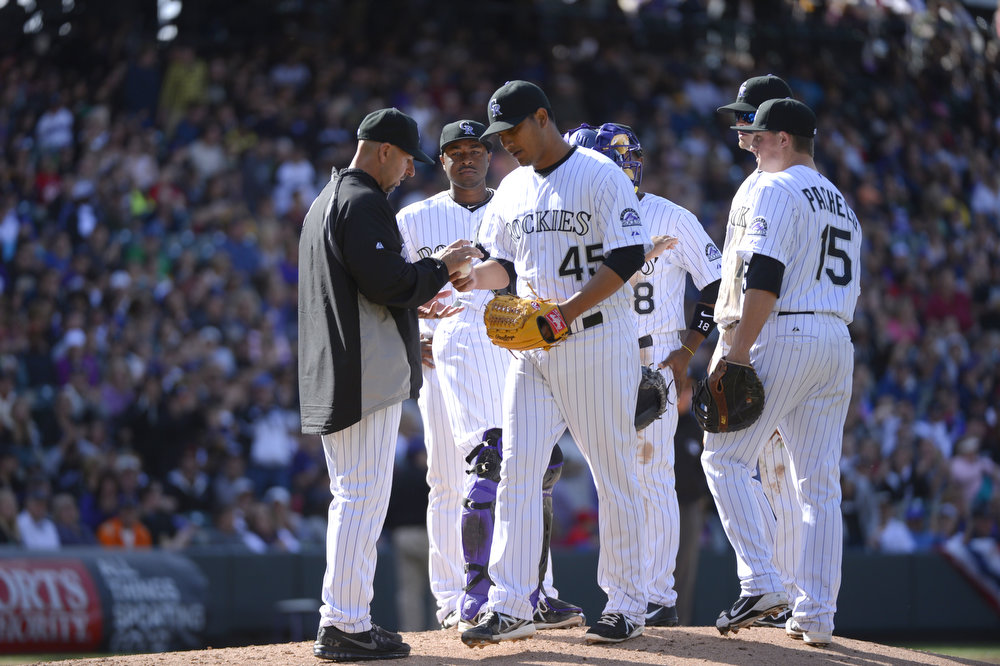 . Colorado Rockies starting pitcher Jhoulys Chacin (45) gives up the ball to Colorado Rockies manager Walt Weiss in the seventh inning against the San Diego Padres April 7, 2013 at Coors Field. (Photo By John Leyba/The Denver Post)